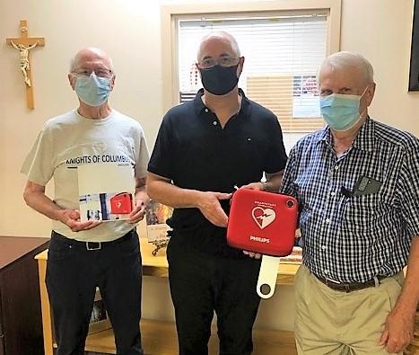 Presentation of Defibrillators by KofC Council 4916